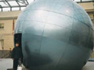 <p>A 5m diameter GRP sphere, tilted on its axis and sliced across its base to provide an interesting enclosure. A ton of display monitors hang inside from our internal steelwork structure.</p>